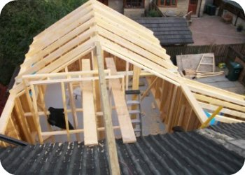At the beginning of day two the roof structure begins to take shape. Having removed a small section of the existing roof, we were able to fit a ridge beam and begin construction of the roof before breaking into the existing roof. This kept the inside of the house dry.