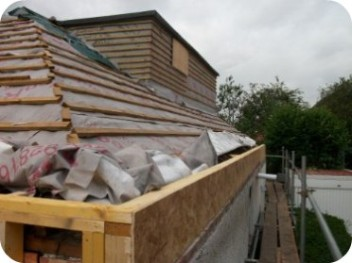 Roof tiles were removed prior to the arrival of Sms Timber Frame.