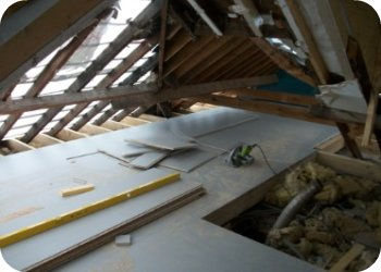 Timber frame floor is decked where possible before existing roof structure is removed.