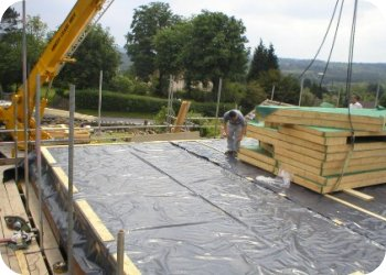 The new timber frame structure is craned onto the new floor structure ready to be erected.