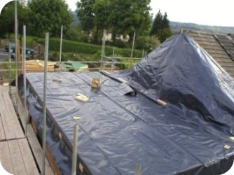 The existing roof structure is stripped progressively and the new floor structure is fitted.
