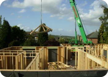 The ground floor timber frame structure begins to take shape ready to accept the floor structure.