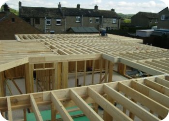 The floor structure is constructed using solid timber joists  and is the decked with weather proof decking.